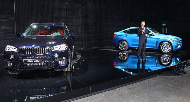 Ян Робертсон, член Совета управления BMW AG, представил динамичный дуэт - BMW X5 М и X6 M в 2014 году в Голливуде